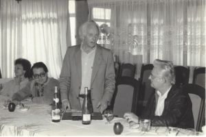 Eloy Kunz receives the touristic distiction  award from the Tourism Secretary from Rio Grande do Sul State (1977).  On the table, Schatzi Riesling wine.
